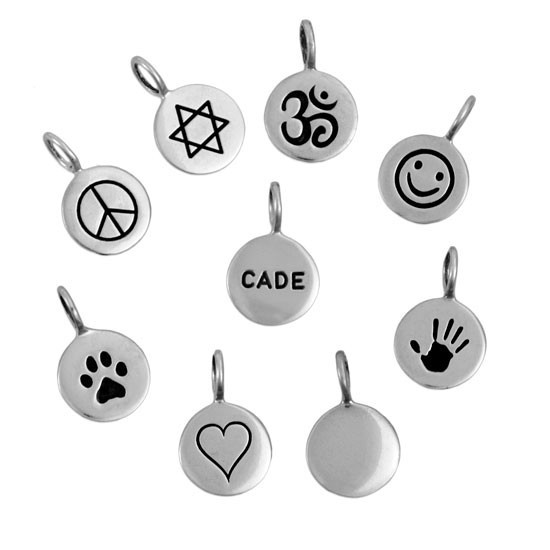 Custom hand stamped symbols on sterling silver on white background