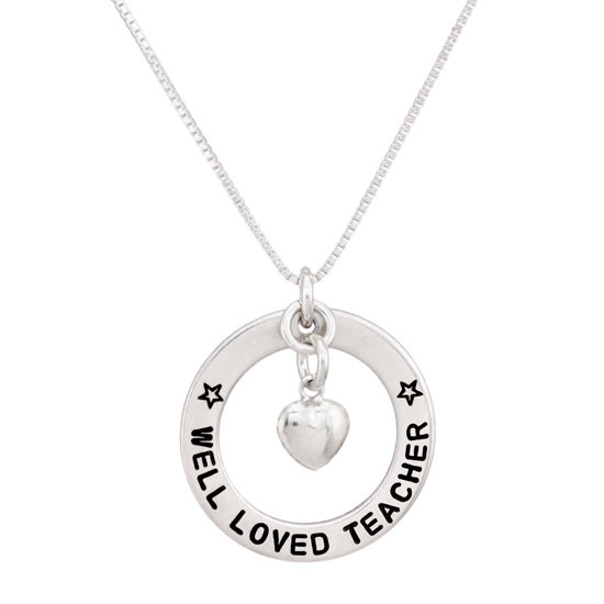 Well Loved Teacher on a Circle, hand stamped sterling silver disc with heart charm, shown close up