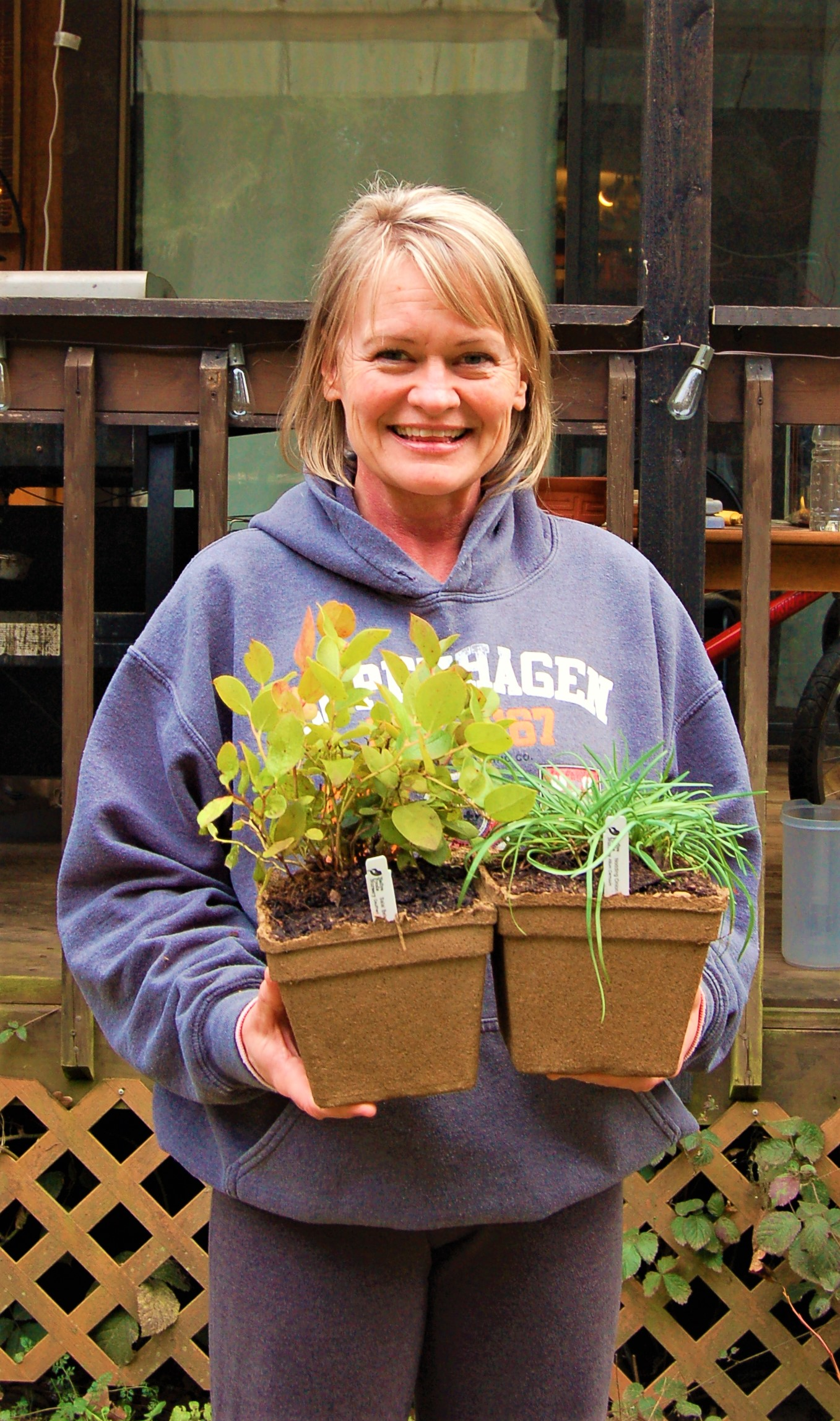 andrea holding potted plant