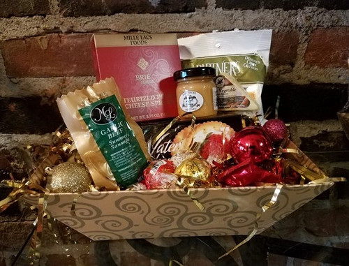 Santa's  Festive Christmas Basket This lovely gift is perfect for corporate giving or friends and family. Filled with summer sausage, cheese, crackers, mustards,  chocolates, coffee and teas.  $74.99 Note: We reserve the right to replace an item if out of stock with equal or greater value.