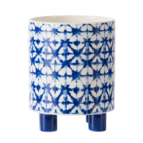 Made of ceramic, this large blue planter features a round body and four legs for a raised design. The watercolor geometric design will enhance your indoor or outdoor space. Showcase real or faux plants in this stunning holder.