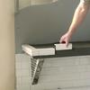 """Innovis 17"""" Corner Shelf (item# BT-17) used to support adjustable bench"""