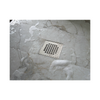 ACO Q-Plus Points Drain installed with square pattern stainless steel grate