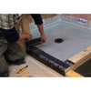 Installing Bituthene Curb Waterproofing in a shower