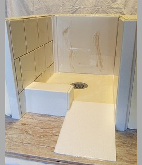 Model of Universal Curbsill and Shower Ramp both made of cultured marble