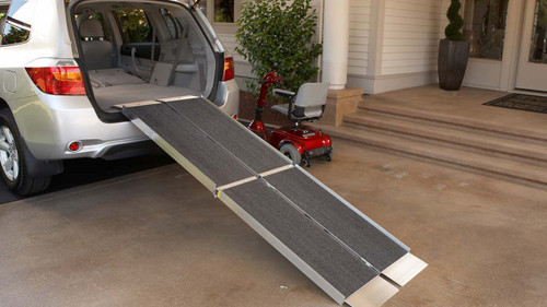 EZ-Access AS Portable Trifold Wheelchair ramp displayed at the back of a van