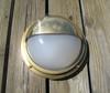 Hooded nautical brass dock light