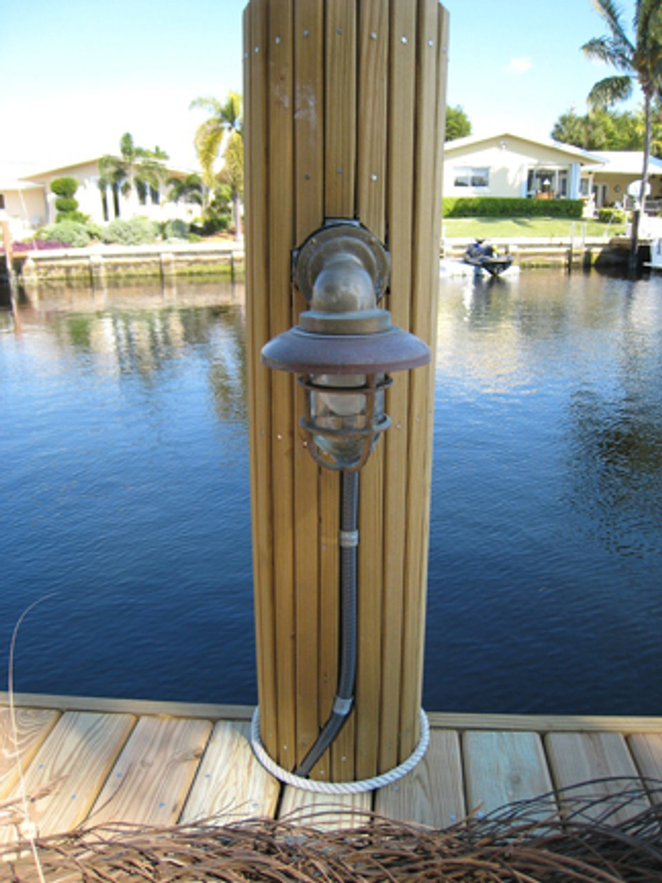 nautical pathway light with conduit coming into the junction box