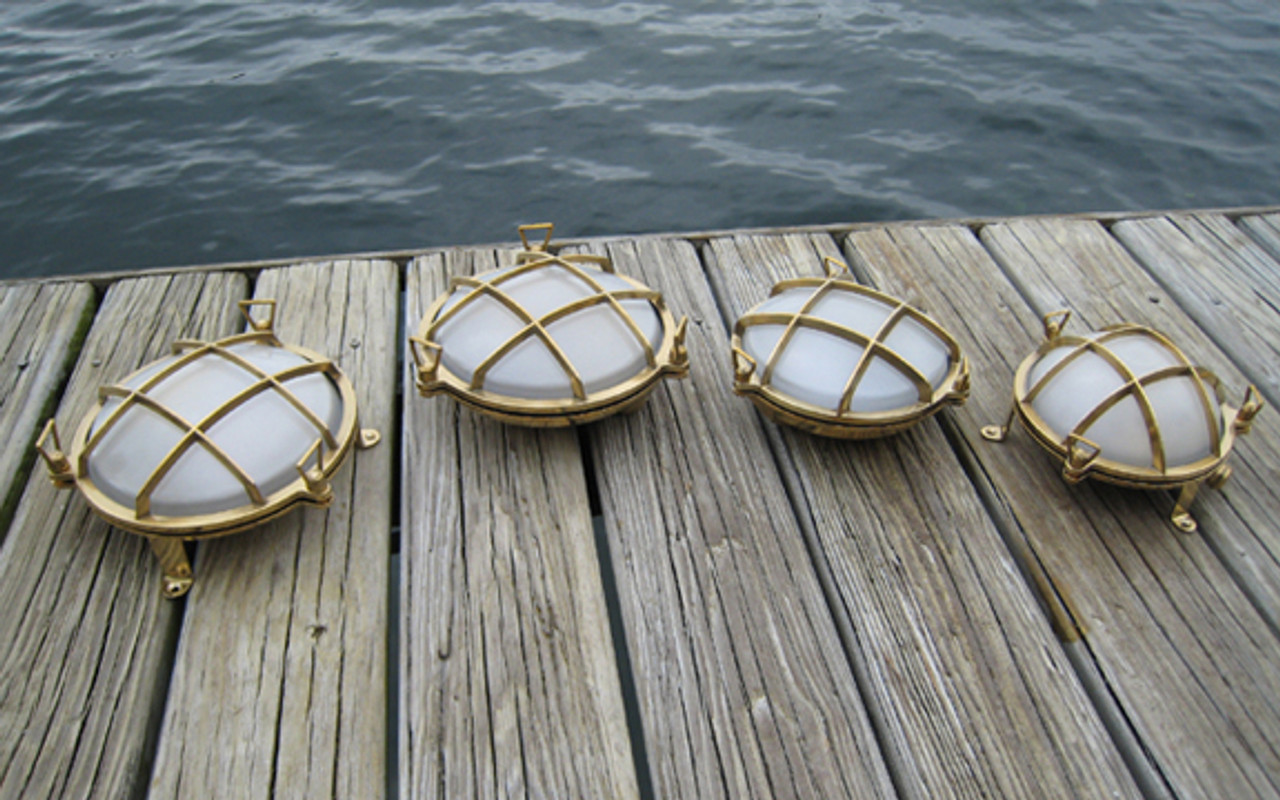 brass round bulkhead light w/feet shown on far left looking at the picture