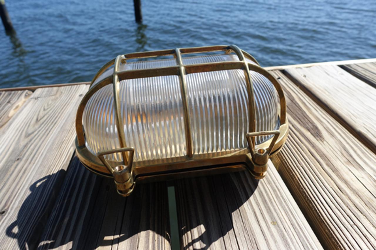 large brass oval dock light