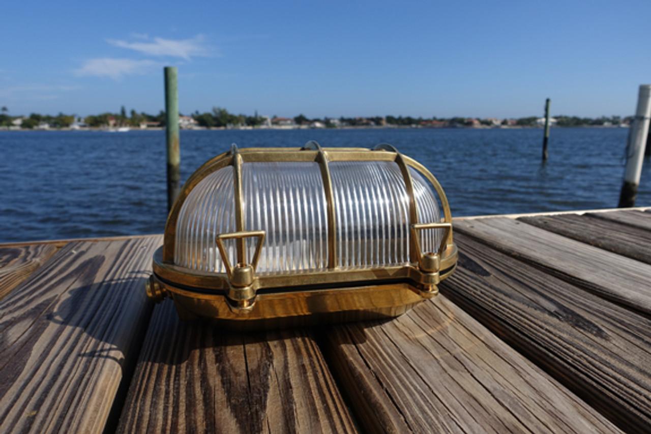 large brass oval nautical light