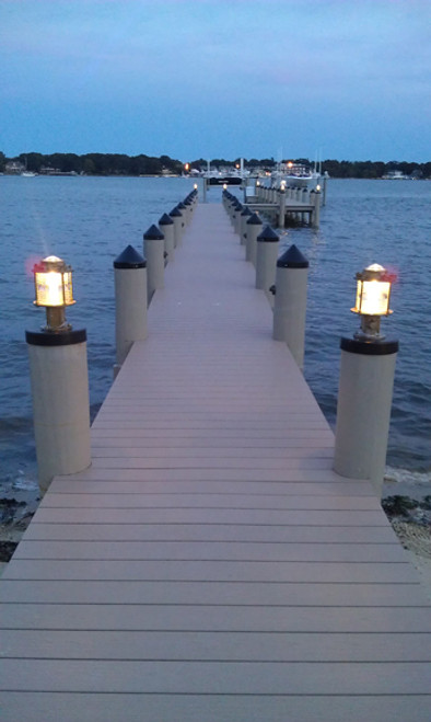 bronze pedestal dock light lit up