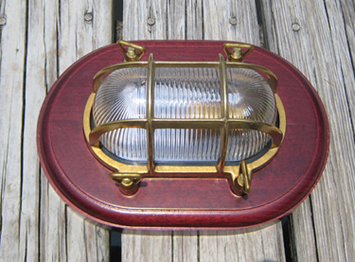oval nautical light with wooden trim ring