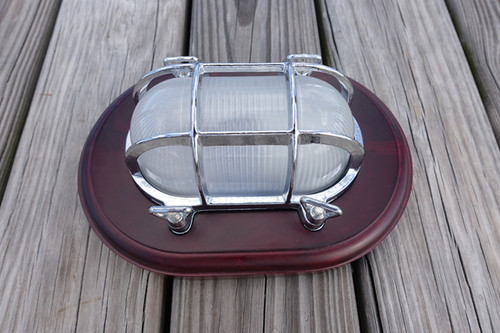 chrome nautical decor light with wooden trim plate