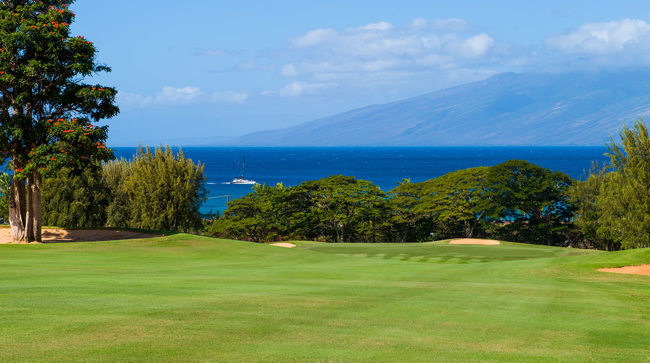 Kapalua Bay Course | Enjoy the West Maui Mountains and the island of Lanai as a scenic backdrop. Book NOW and SAVE $10pp at Kapalua Bay Course | Maui Golf Shop