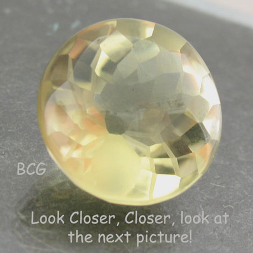 Yellow Citrine #IT-1667 with a spider faceted into the pavillion