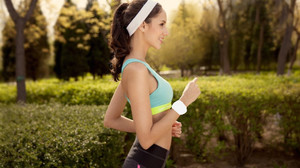 Female Jogger Wearing White Sports Headband & Wristband