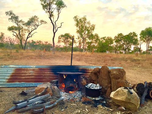 Australian outback camp with fire pit and camp oven