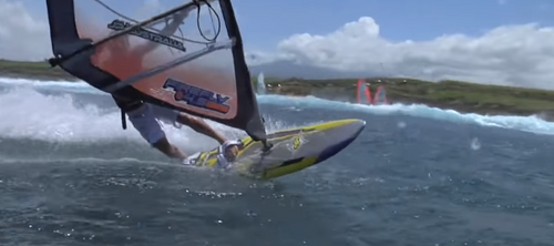 Windsurfer with white shorts surfing at sea