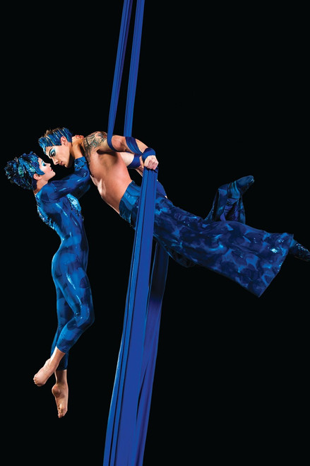 Male and female dancers suspended on navy blue aerial silk