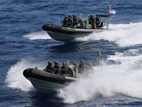 Two speeding rigid hulled inflatable boats (RIBS) with crews