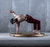 Male dancer leaning backwards on a metallic gold crash mat