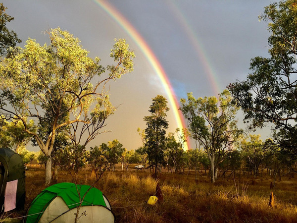 Australian outback campsite with double rainbows