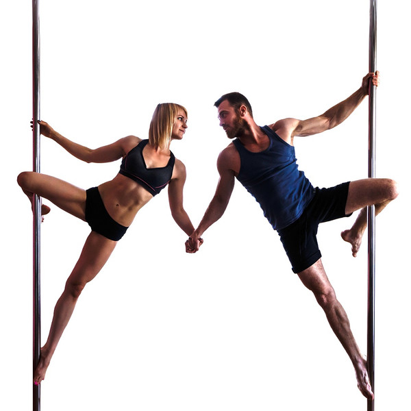 Male and female dancers each balanced on a pole and holding hands