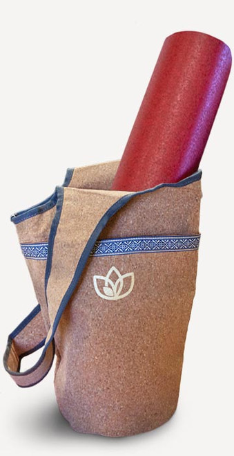 Cork yoga mat tote bag with roomy interior, large outer pocket with zippered accessory pockets, fully lined interior with wide carry strap — product view