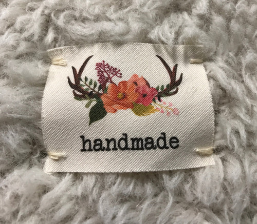 antler 'handmade' sewn-in tag