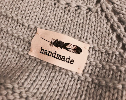 feather 'handmade' sewn-in tag