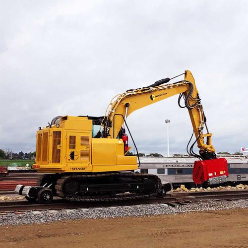 Supertrak Hi Rail Excavator upfitted with mulcher attachment