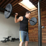 45 lb. olympic barbell by SteelBody will complete your home gym in use by model - squat