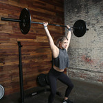 45 lb. olympic barbell by SteelBody will complete your home gym in use by model - power lift