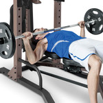 The Steelbody STB-98502 Power Tower with Foldable Bench in use - bench press