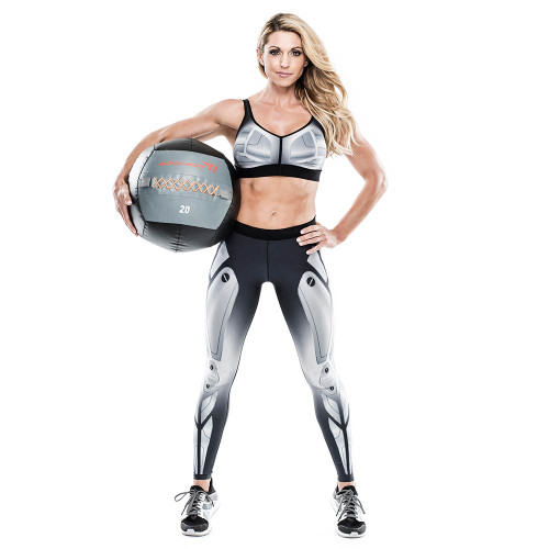 Kim Lyons holding the Bionic Body 20 lb. Medicine Ball