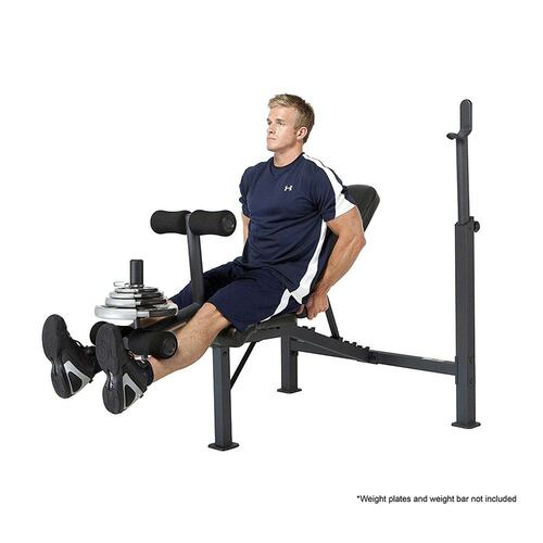 The Olympic Bench Competitor CB-729 in use by model - leg extensions