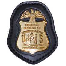 F.B.I. RETIRED BADGE HOLDER