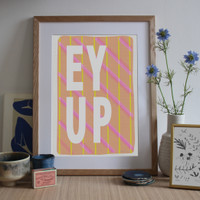 Illustrated art print with a classic Yorkshire saying 'Ey Up' written over a bright, modern patterned design.