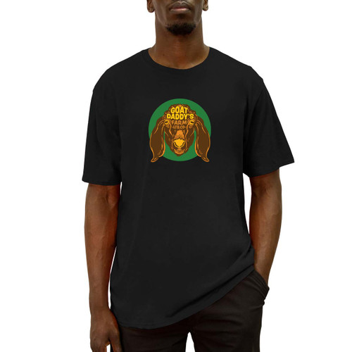 Front of a black short sleeve tee with green, brown, and yellow goat design on the front.