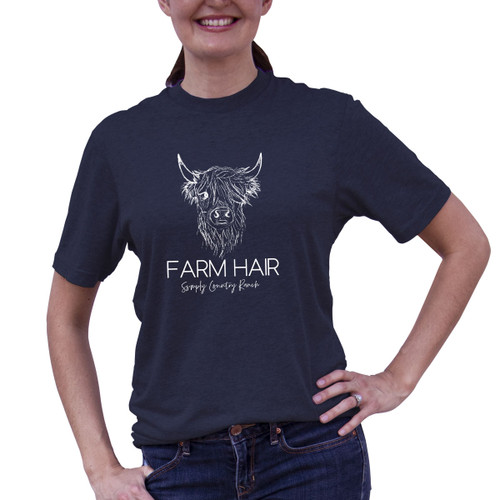 Woman wearing Patriot Blue legendary tee with Farm Hair design in white.