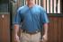 Man wearing a blue blended tee shirt.