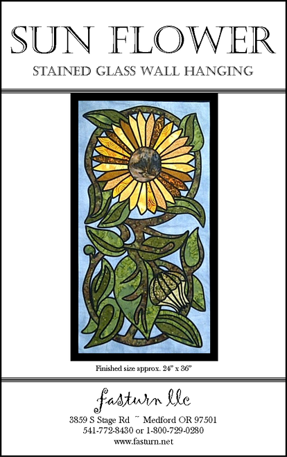 This lovely Sunflower pattern was inspired by a broken kitchen tile we found in a junk shop in Boston, MA.  This stained glass pattern uses fusible applique (Light Steam-A-Seam II) & fabric tubes for the leading lines.
