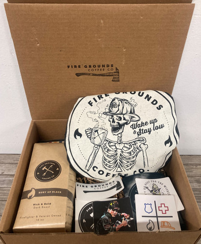 What's Inside? A Fire Grounds Vintage T Shirt, A 1lb bag of Fire Grounds Coffee, All 5 of our stickers, and our Fire Grounds Koozie.