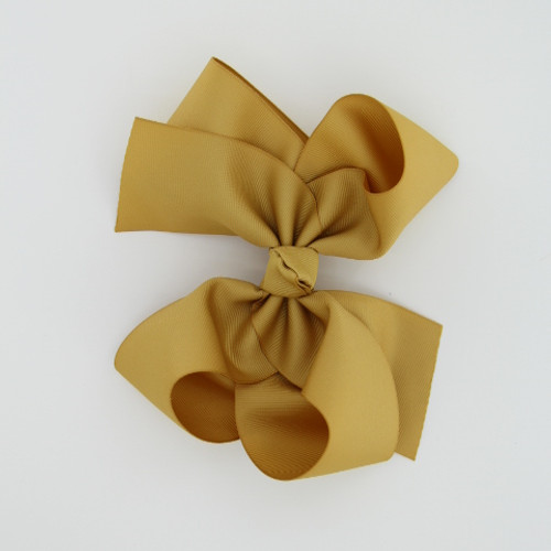 "Item no.        : egch, Size              : 7.5""X6""  Color            : Antique Gold Center          : Cone Ribbon Size : 2 1/4"" Type of Clip : French Clip Made in USA"
