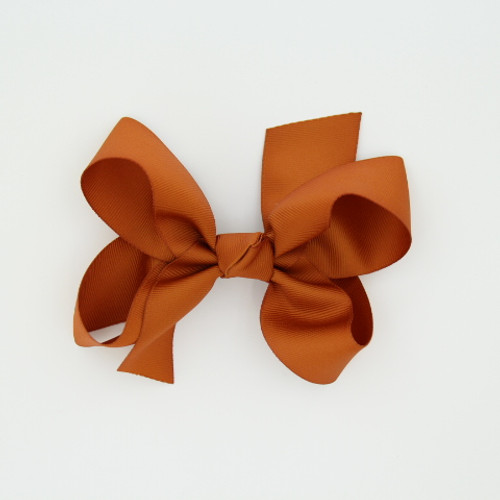 "Item no.: dgch, Size: 6""X5"", Color: Burnt Orange,  Ribbon Size: 1 1/2"", Center: Cone,   Type of Clip: French Clip        MADE IN USA"