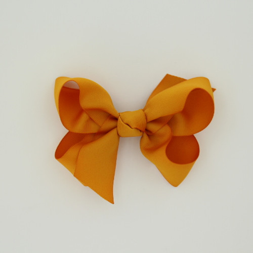 """Item no.: dgcs, Size: 6""""X5"""", Color: Pumpkin,  Ribbon Size: 1 1/2"""", Center: Cone,   Type of Clip: French Clip        MADE IN USA"""