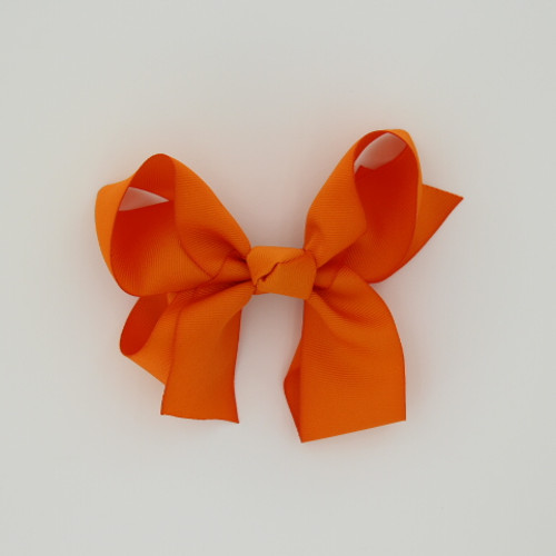 "Item no.: dgcs, Size: 6""X5"", Color: Lt. Orange,  Ribbon Size: 1 1/2"", Center: Cone,   Type of Clip: French Clip        MADE IN USA"