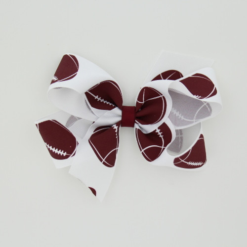 "Item no.: dgcsfot, Size: 6"" X 5"",  Color: White Burgundy Center ""Football"",  Center: plain,  Ribbon Size: 1 1/2""   Type of Clip: Aligator clip        MADE IN USA"