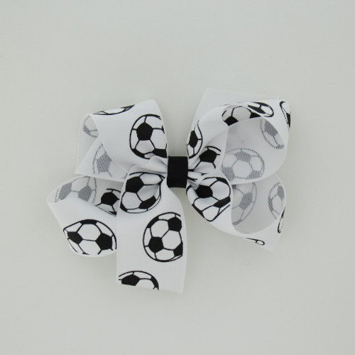 "Item no.: dgcssoc, Size: 6"" X 5"",  Color: White Black Center ""Soccer"",  Center: plain,  Ribbon Size: 1 1/2""   Type of Clip: Aligator clip        MADE IN USA"